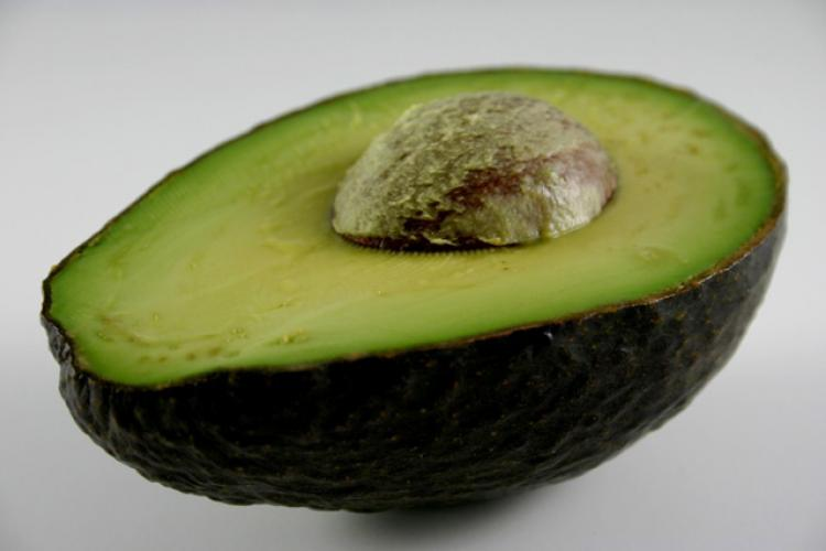 Half an avocado with the stone in the middle.