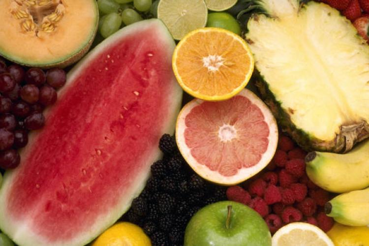 A selection of fruit including grapes, melon, watermelon, citrus fruits, berries, banana and pineapple.