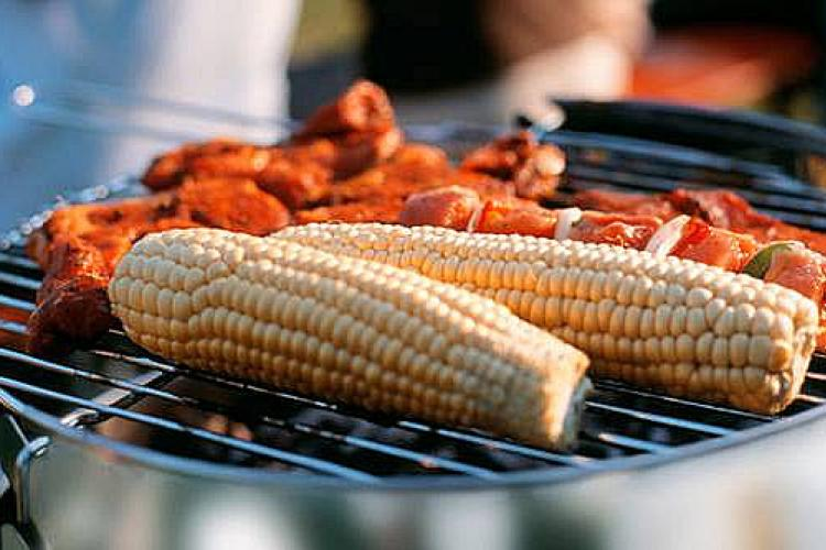 Corn and meat on a barbecue.