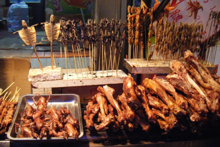 Varitey of cooked meats in a food stand in Beijing.