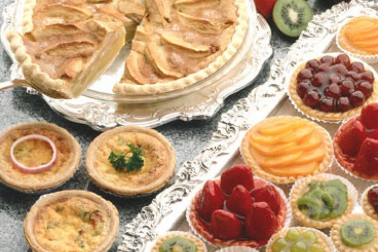 A variety of sweet open crust pies and tarts.