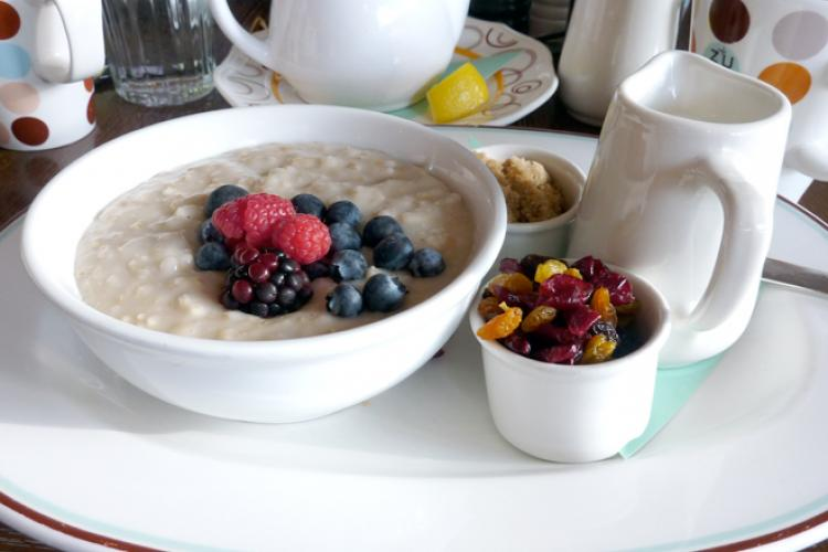 A bowl with oatmeal and fruit.