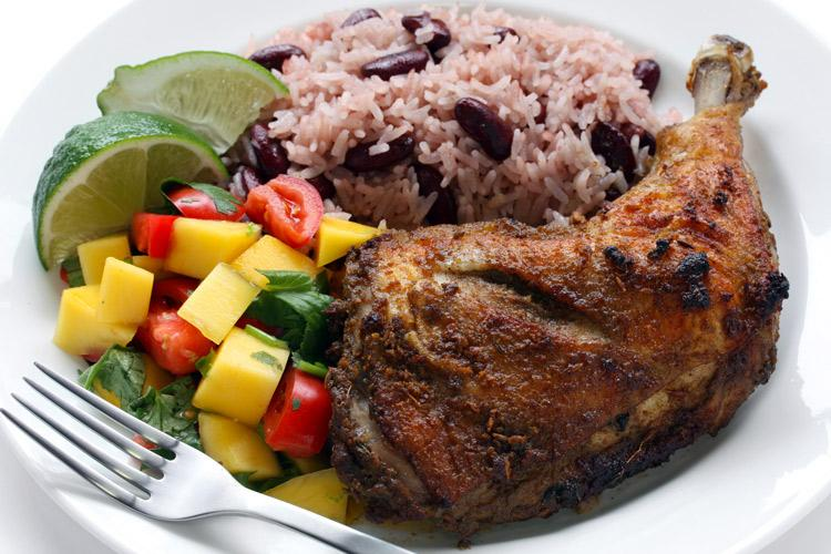 Jamaican jerk chicken wir rice and salad.