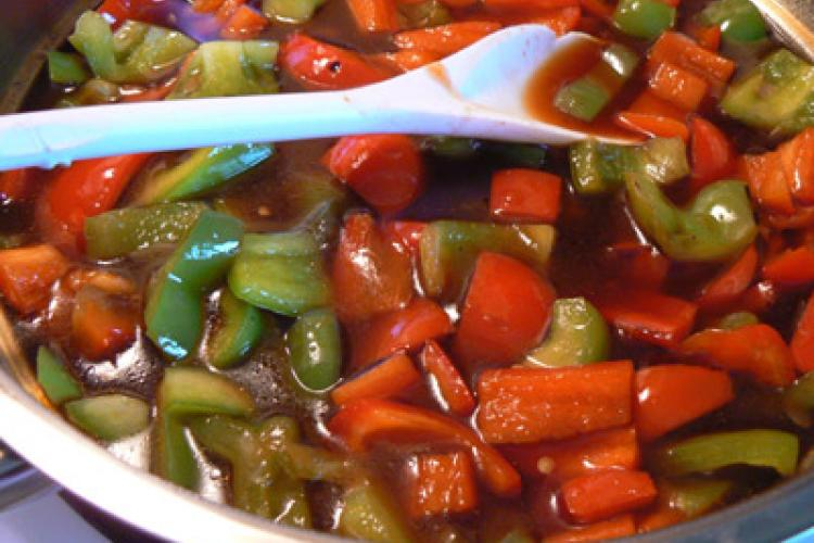 Sweet and sour sauce with red and green peppers.