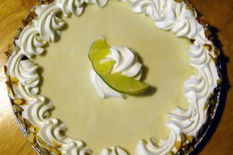 Key lime pie decorated with whipped cream.