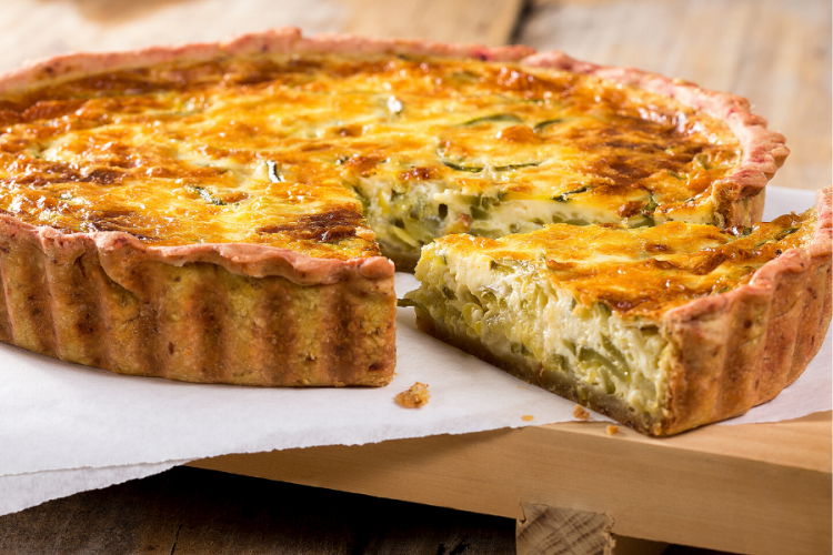 Leek and cheee pie with a slice cut.