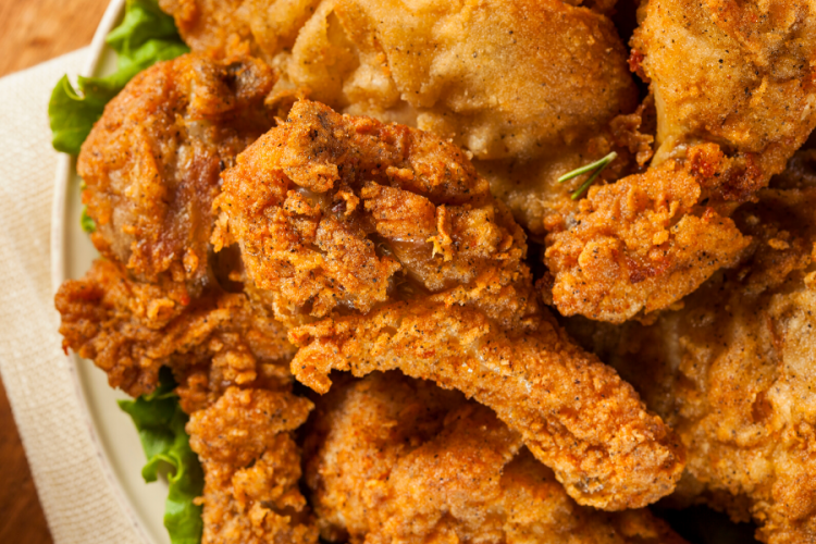 Southern fried chicken on a serving plate.