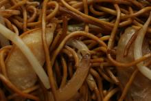 Detail of chow mein with noodles and vegetables.