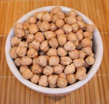 Chickpeas, or garbanzo beans, in a white bowl.