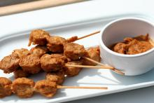 Small chicken satays and spicy peanut sauce for dipping.